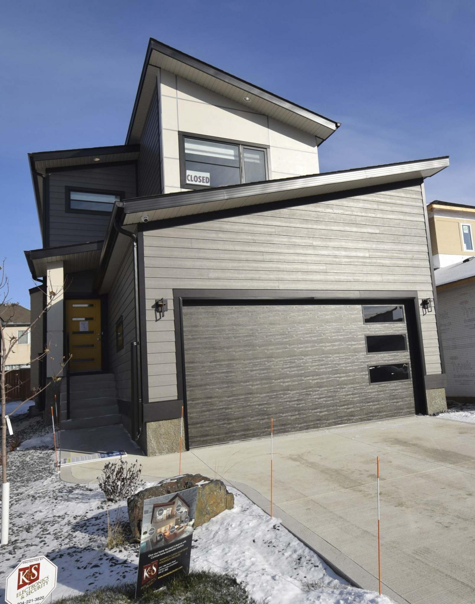 <p>Photos by Todd Lewys / Winnipeg Free Press</p><p>This new two-storey design by Hilton Homes features a striking exterior and an efficient floor plan. </p>