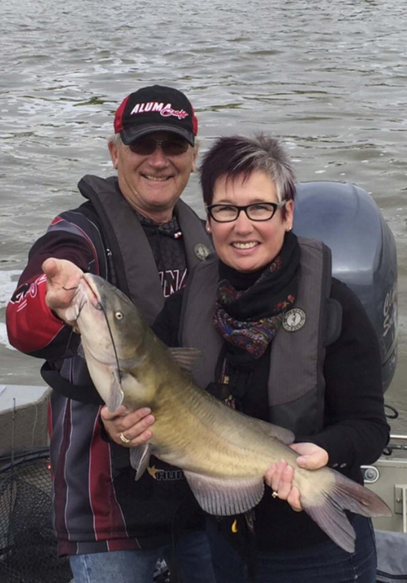 <p>Supplied</p><p>Hooked on Shelter Fishing Derby organizer Donna Kirsch, along with Clancy Solomon, proudly displays the catfish she caught at the 2015 tournament. This year's event, the 10th annual edition, gets underway Sept. 21 at Selkirk Park. Registration is $65.</p>