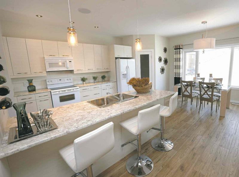The Kitchen And Dining Area. Kensington Homes� Sales Rep Is Heather  Daniels. Todd Lewys Story Wayne Glowacki / Winnipeg Free Press Jan.