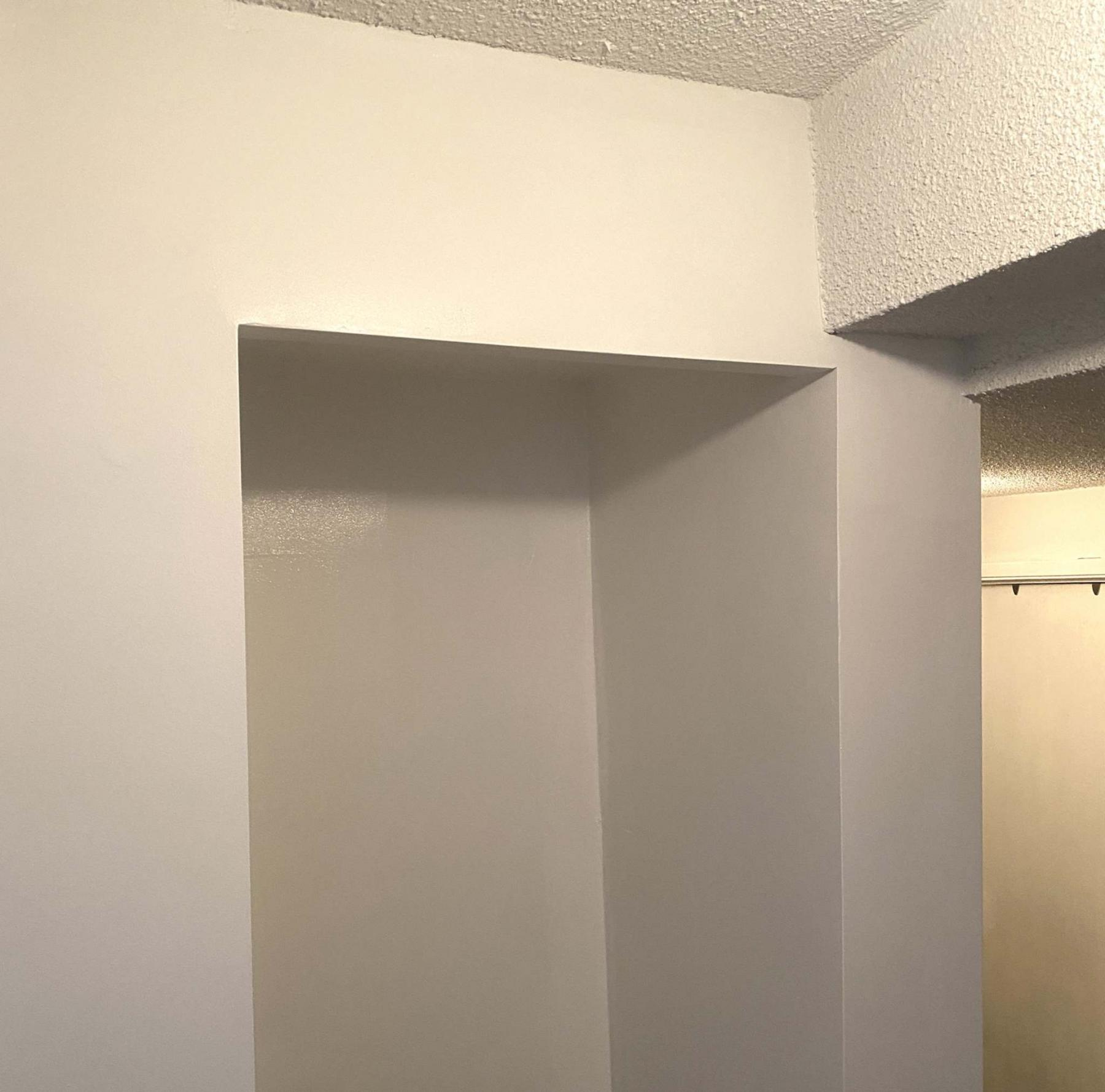 <p>A flat vertical surface was created on which the four cabinet doors could rest when closed.</p></p>