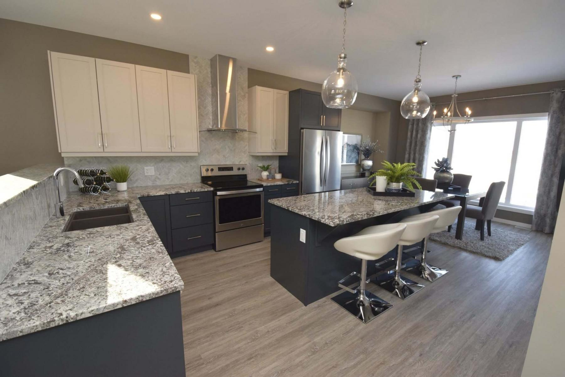 <p>TODD LEWYS / WINNIPEG FREE PRESS</p><p>Plenty of granite gives the kitchen a touch of luxury.</p>