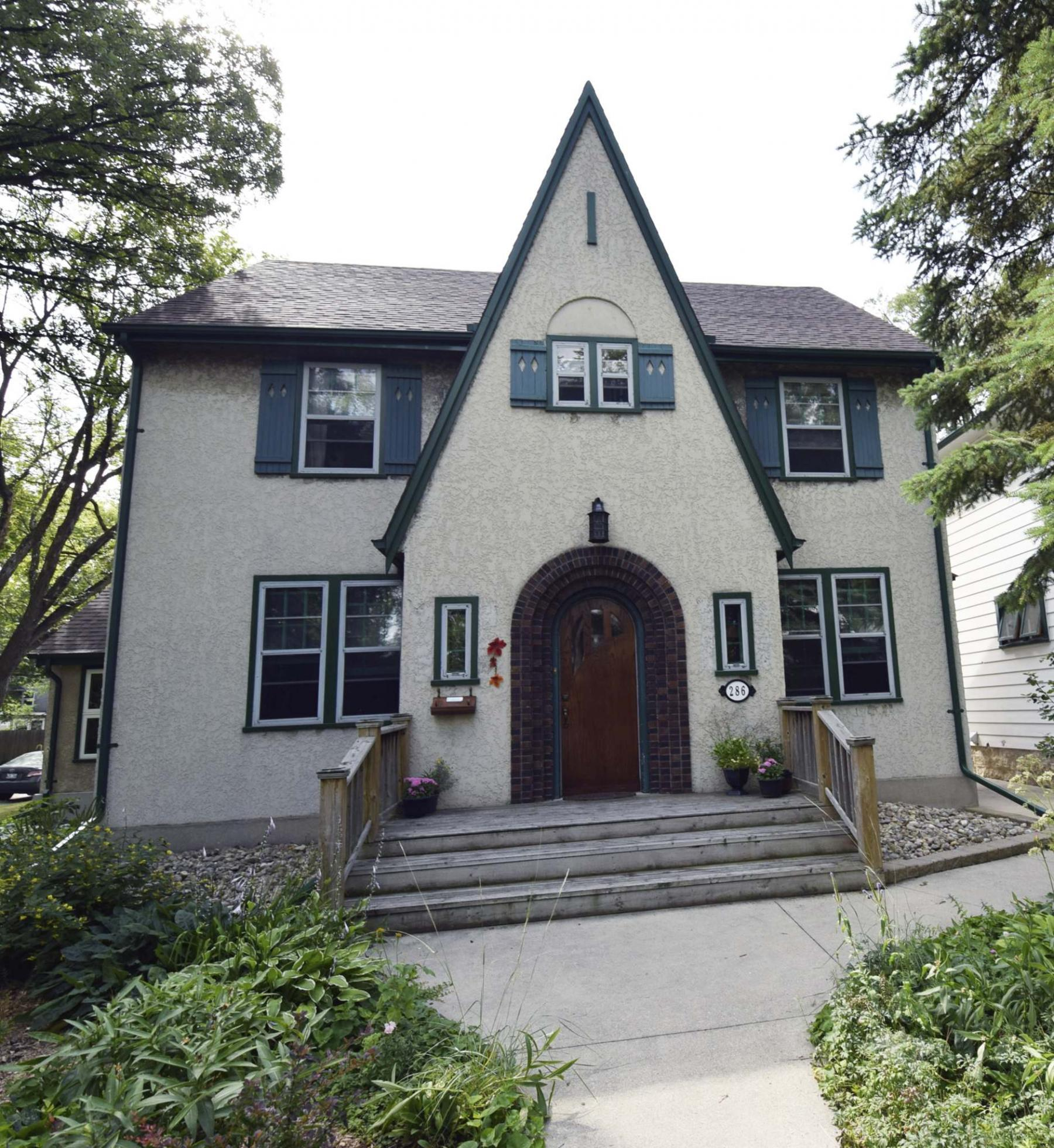 <p>Photos by Todd Lewys / Winnipeg Free Press</p><p>Situated on an oversized corner lot, this classic two-storey home is surrounded by lush gardens and mature trees.</p></p>