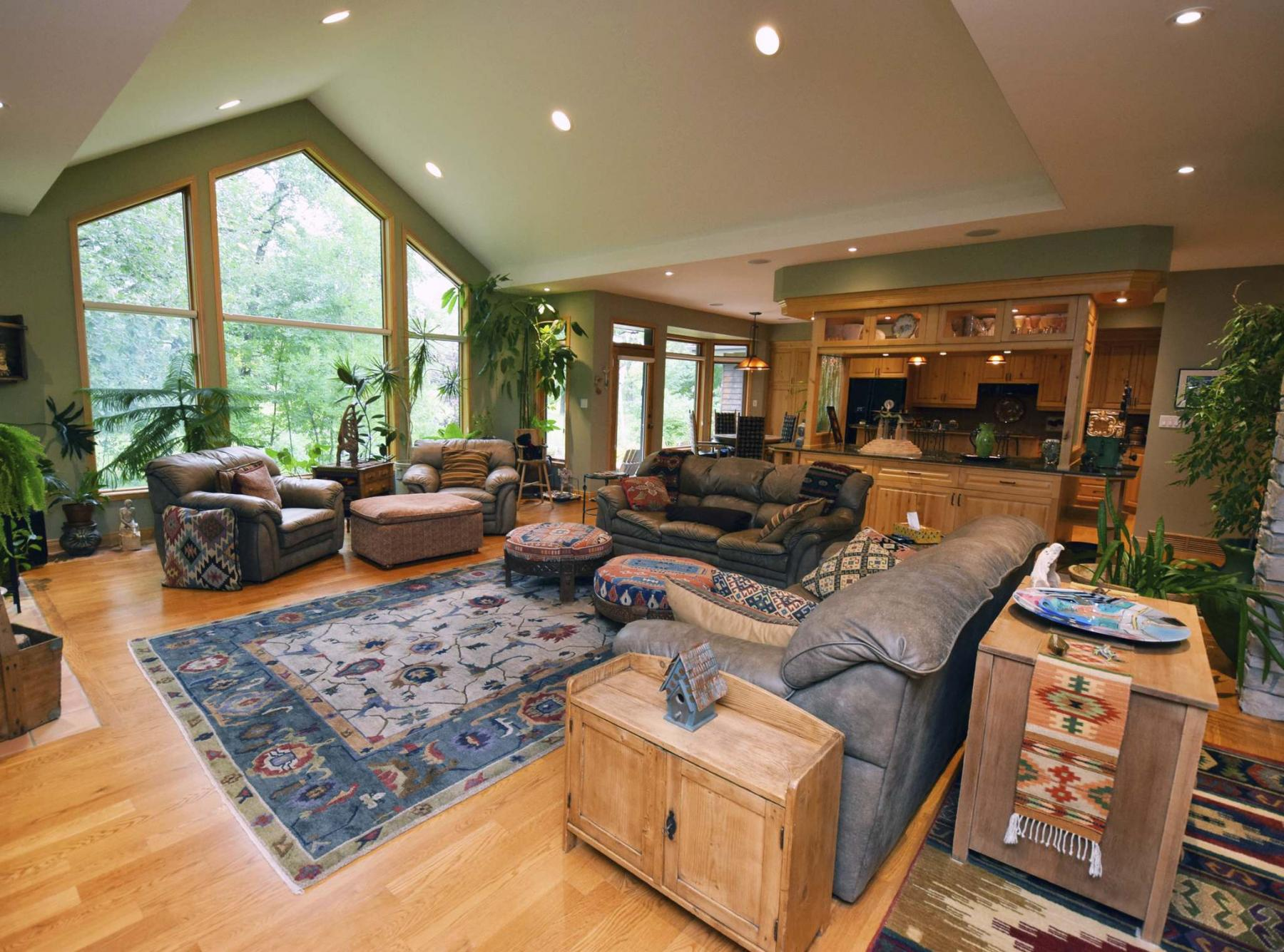 <p>Photos by Todd Lewys / Winnipeg Free Press</p><p>With a vaulted ceiling and massive windows, the living room has a stunning view of the property's park-like backyard.</p>