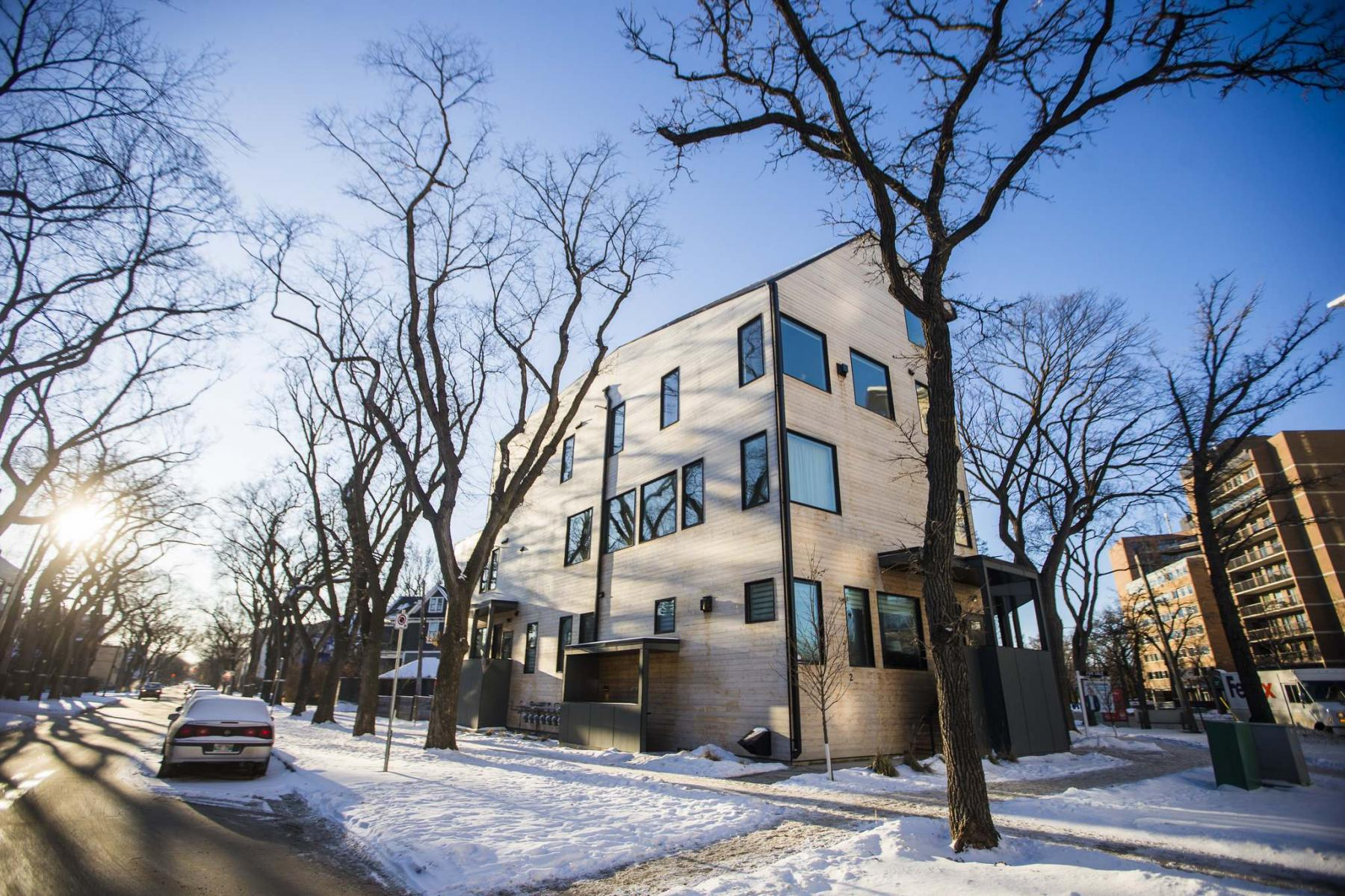 <p>MIKAELA MACKENZIE / WINNIPEG FREE PRESS</p></p><p>The exterior of 234 Wellington Crescent is a modern design with rustic charm. </p>