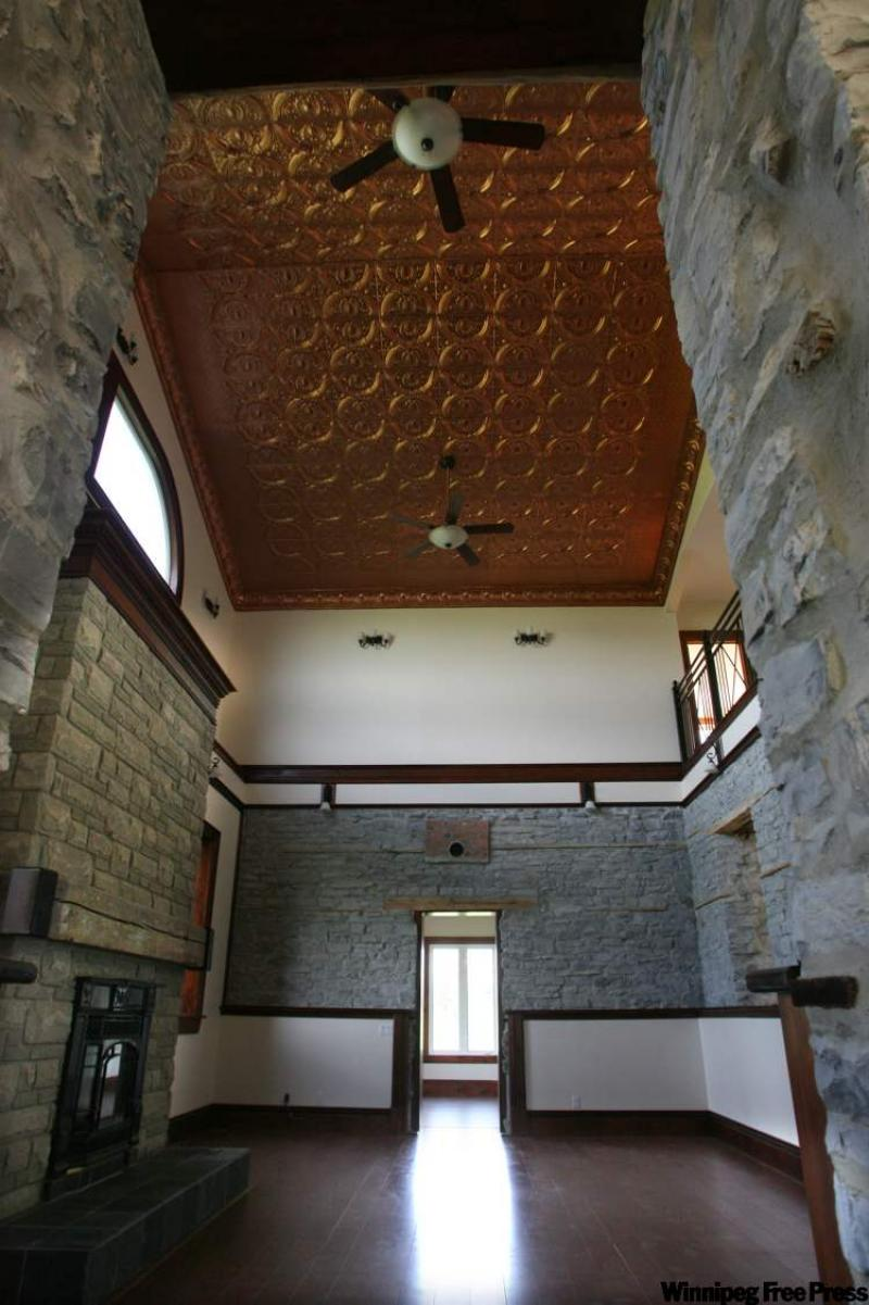 Decorate your home with a hot tin roof winnipeg free press homes for Hot tin roof custom home design