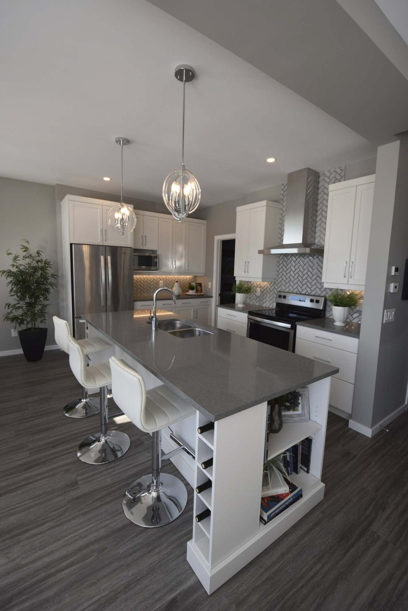 <p>Todd Lewys / Winnipeg Free Press</p><p>The island kitchen in this spacious two-storey home is the definition of modern style and function.</p>