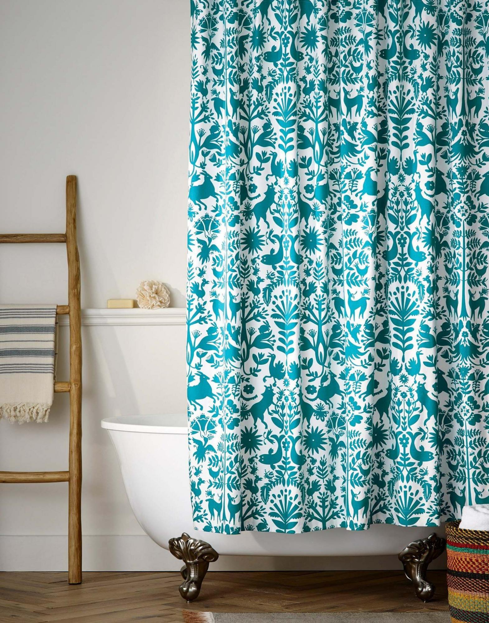 <p>Hygge & West</p><p>The Otomi Shower Curtain in turquoise from Hygge & West. Turquoise is a versatile design colour and can add a bright twist. </p>