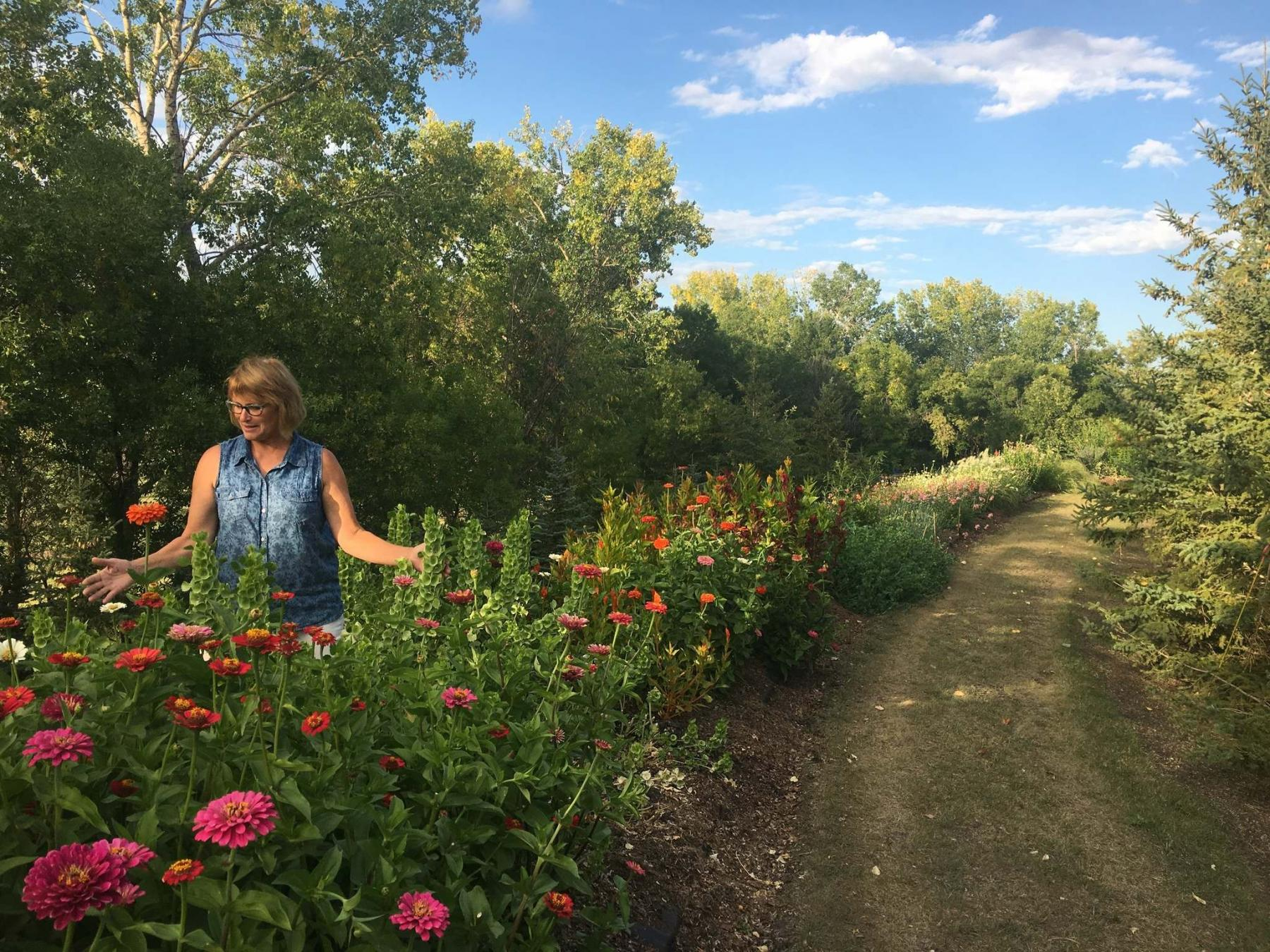 <p>Photos by Angela Neufeld</p><p>Terry Neufeld, owner of Sweet Petals Farm, is making plans to grow her flower business.</p>