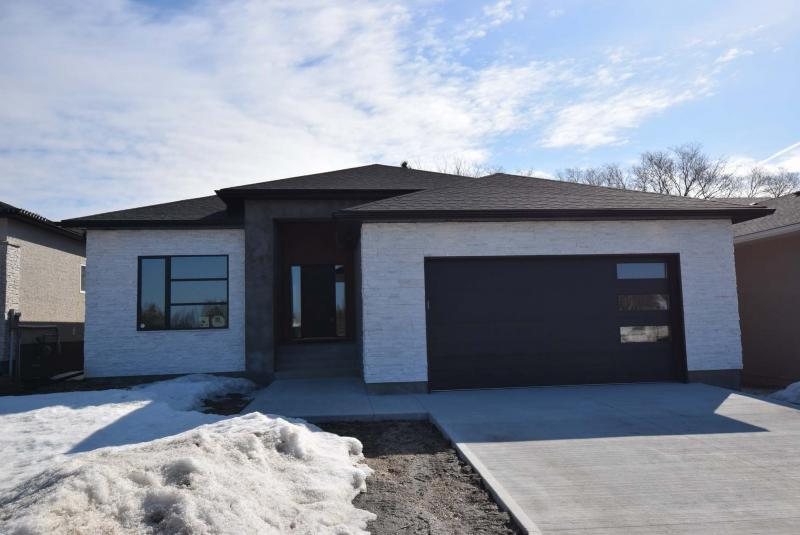 <p>Photos by Todd Lewys / Winnipeg Free Press</p><p>Warren Earl of Taylor Ridge Homes says a lot of thought went into the design of this 1,734-square-foot bungalow.</p>