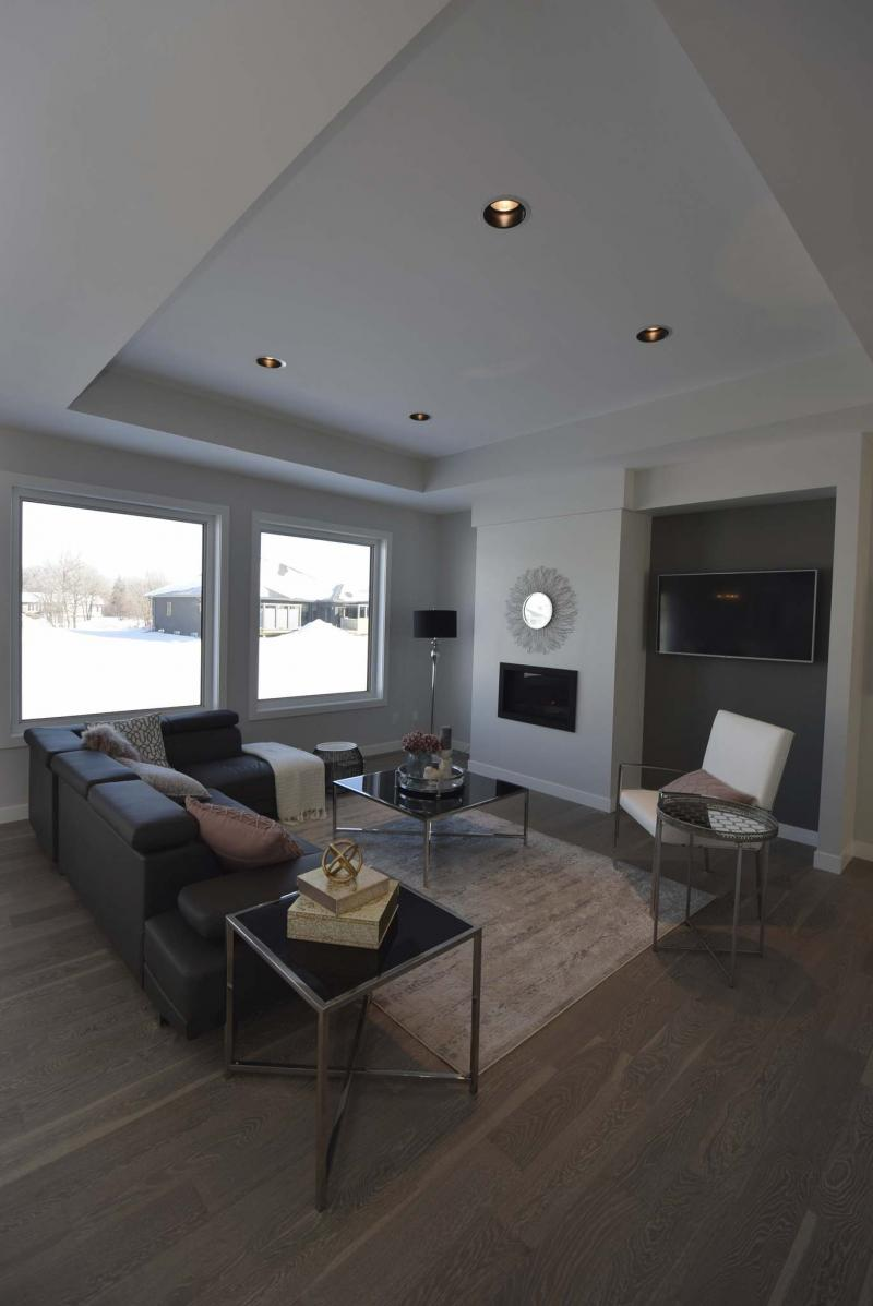 <p>The family room features a TV niche with grey feature wall and gas fireplace with white surround that can be tiled.</p>