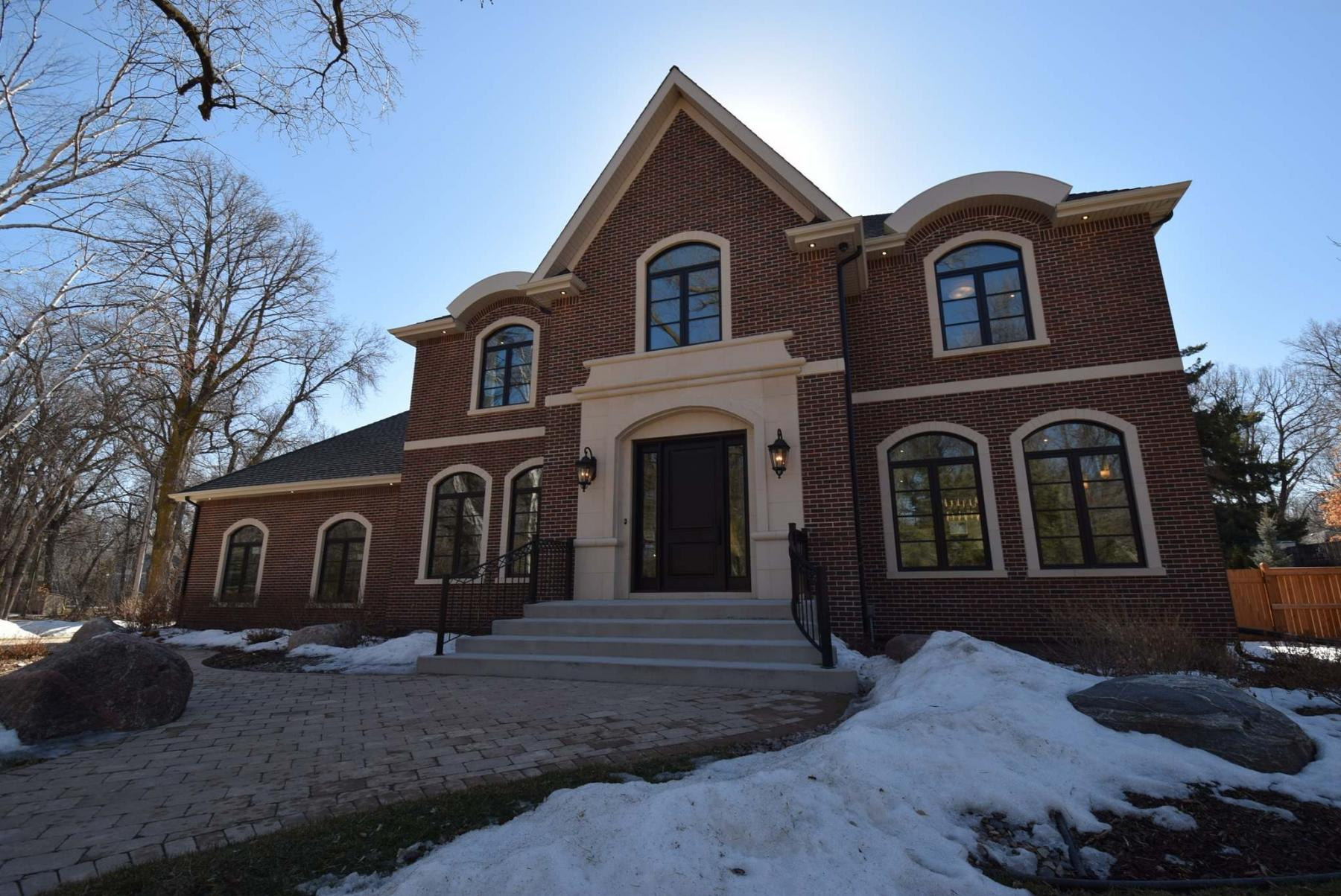 <p>Photos by Todd Lewys / Winnipeg Free Press</p><p>An exterior clad with red brick and earthy limestone give this two-storey masterpiece a rich, timeless look.</p>