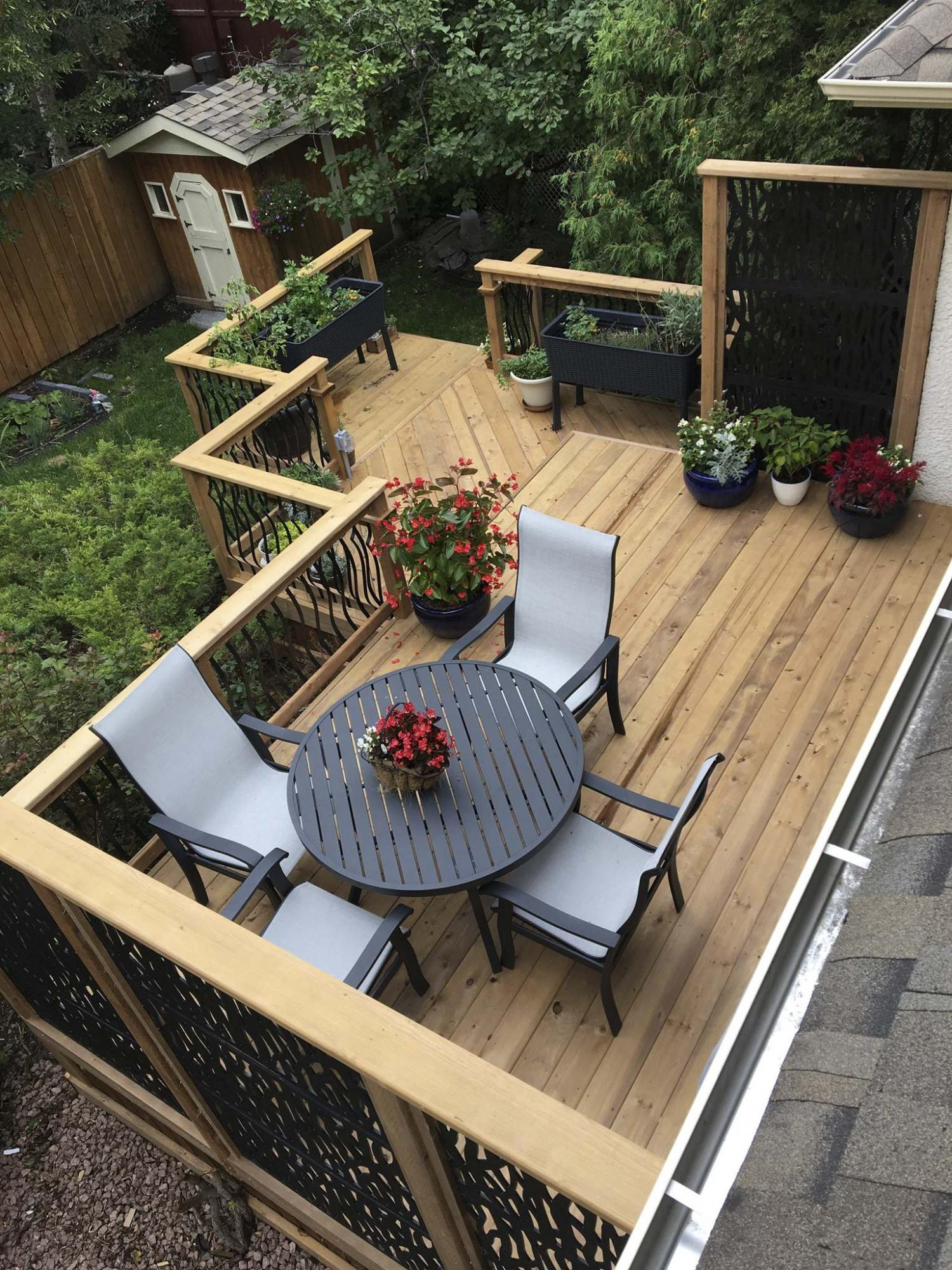 <p>Marc LaBossiere / Winnipeg Free Press</p><p>The three-tiered deck — featuring cascading railings with black metal balusters and two privacy walls with black plastic decorative panels — provides a peaceful backyard sanctuary.</p>