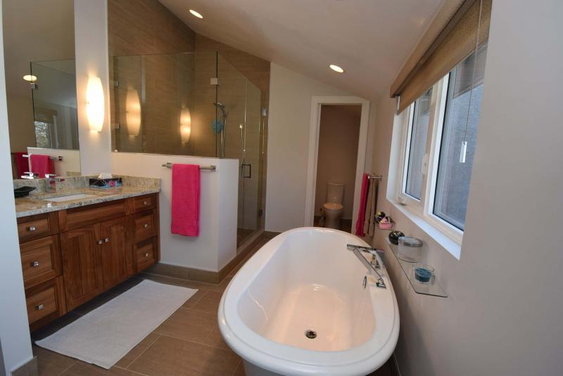 <p>The master bedroom's ensuite bathroom features a soaker tub and five-foot custom shower.</p></p>