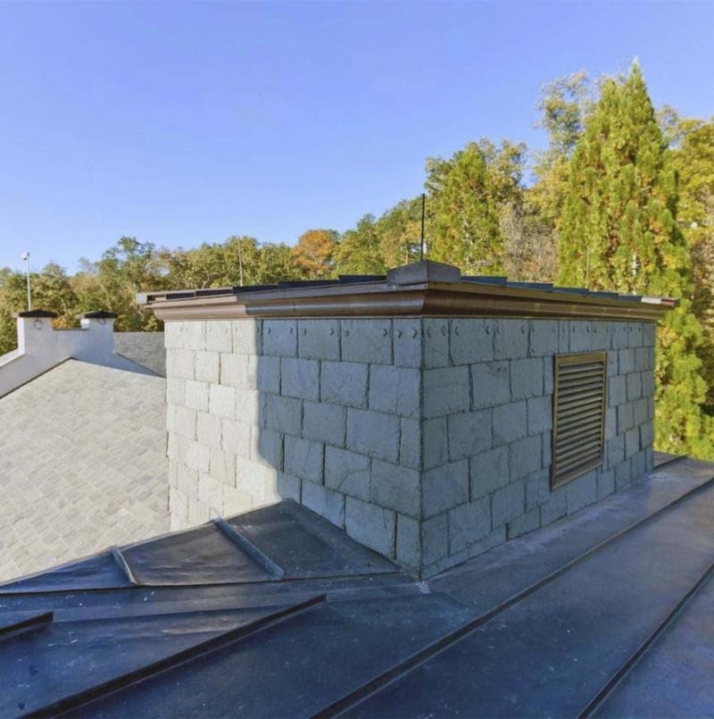 <p>Courtesy of Paul Wegener / Atlanta Fine Homes Sotheby's International Realty</p><p>The observation tower comes with a glass floor and hidden spiral staircase so residents can make a quick getaway. This view toward the rear of the home shows the different types of roofing materials used. </p></p>