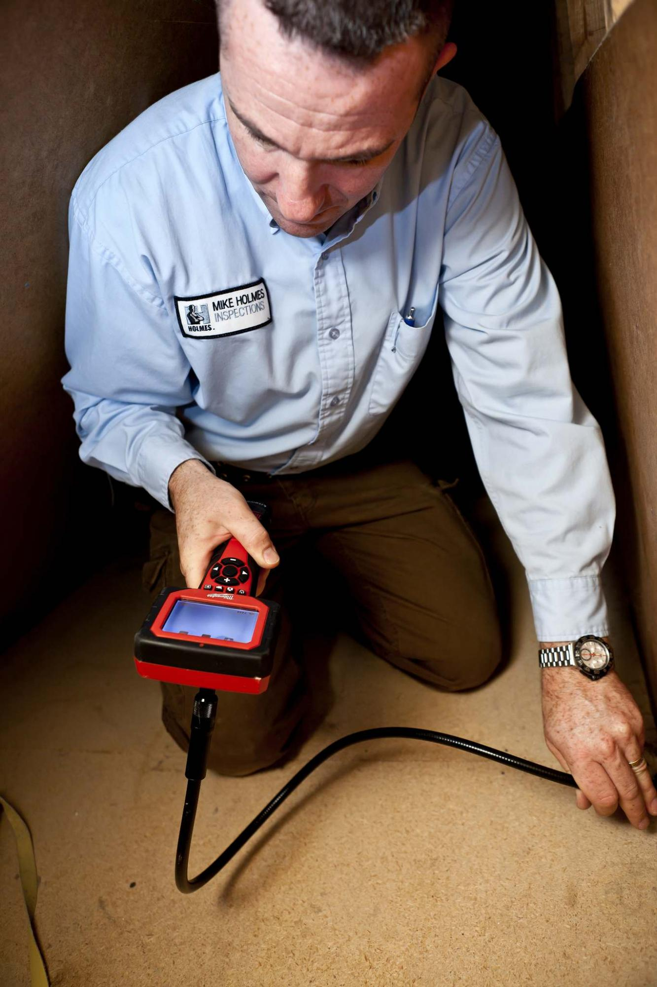 <p>Holmes Group</p><p>A home inspector inspects a crawlspace. Properly insulating and sealing the perimeter and dirt floor of a crawlspace prevents excess moisture.</p>