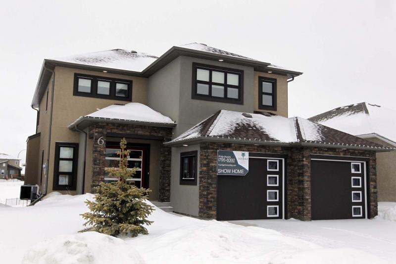 <p>BORIS MINKEVICH / WINNIPEG FREE PRESS</p><p>This stunning two-storey house, located at 6 Camira Way, is featured in the Spring Parade of Homes. </p>