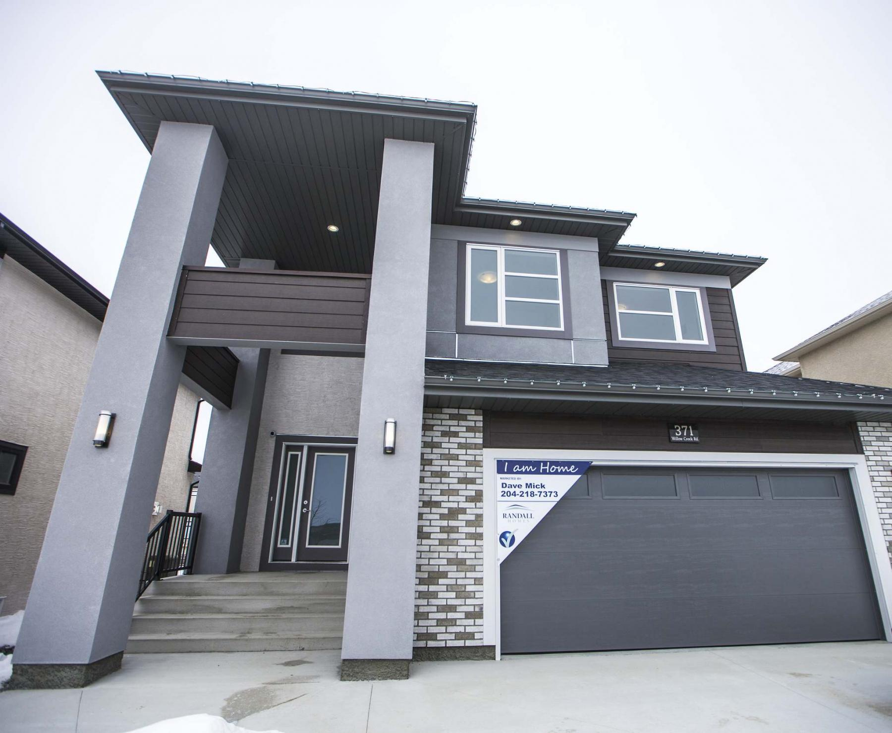 <p>Photos by MIKAELA MACKENZIE / WINNIPEG FREE PRESS</p><p>This attractive show home on Willow Creek Road in Bridgwater Trails has plenty of curb appeal. It is on display now in the MHBA's Spring Parade of Homes.</p>
