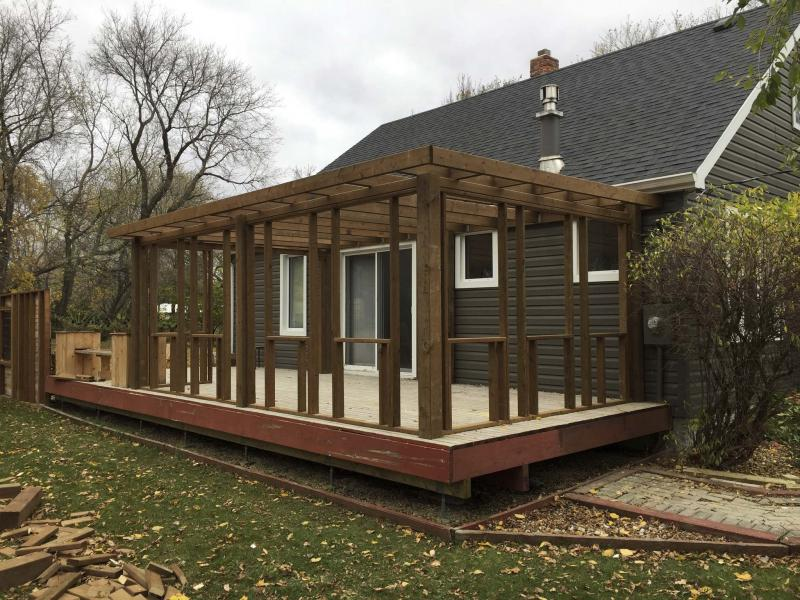 Deck turned into sunroom winnipeg free press homes for Sunroom plans free