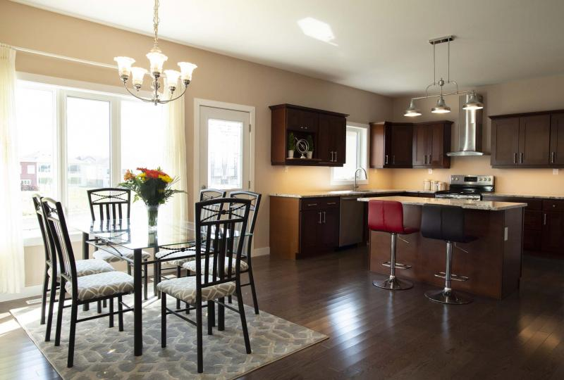 <p>ANDREW RYAN / WINNIPEG FREE PRESS</p><p>The kitchen of Transcona's 185 Shady Shores Dr. is a spacious 23- by 16-foot space with a dinette area for four to six people, featuring a cappuccino-stained hardwood floor, granite countertops and cherry cabinets.</p></p>