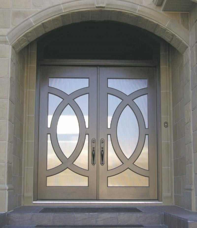 Circle door by Yarrow Sash and Door stained cherry with glass inserts in circular frames. & RENOVATIONS: Youu0027ll a-door it - Winnipeg Free Press Homes