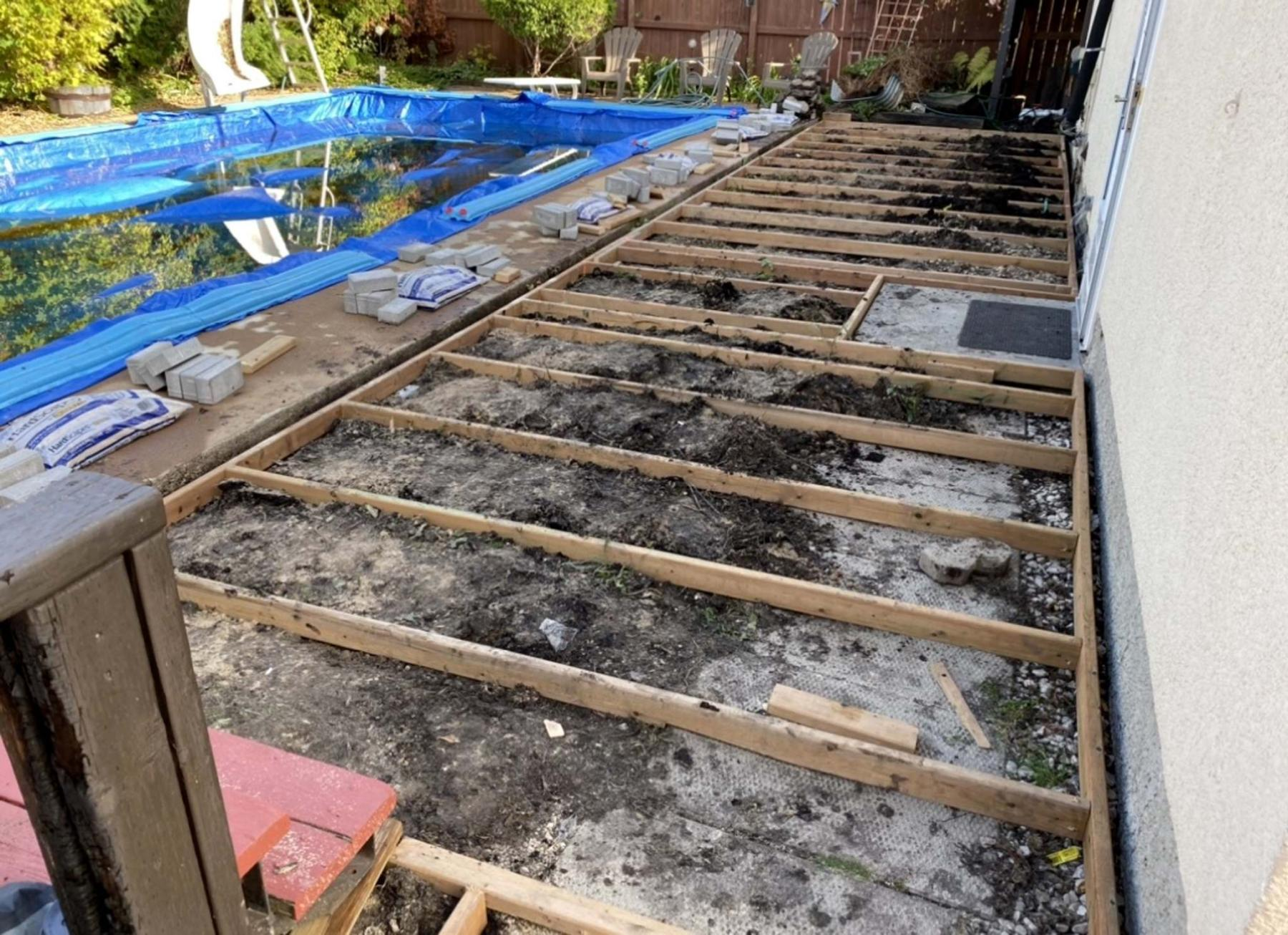 <p>The 2x6 brown-treated boards (left) complete the top-decking of the 2x4 framework for the low-level deck. The 2x4 joists (above) are set onto blocks within troughs pre-dug in the ground to meet elevation requirements and maintain level throughout the deck's surface.</p>