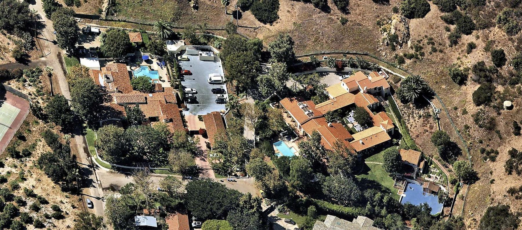 <p>NearMap / Handout</p><p>Blockbuster filmmaker James Cameron is seeking $25 million for his two-house compound in a gated Malibu community. The two properties combine for about four acres of grounds, 16,000 square feet of living space, 11 bedrooms, 13 bathrooms and two swimming pools.</p></p>