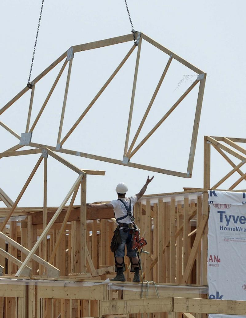 <p>Sean Kilpatrick / Canadian Press Files</p><p>Framers hard at work were a familiar sight across Winnipeg and area in 2017, as housing starts soared.</p>