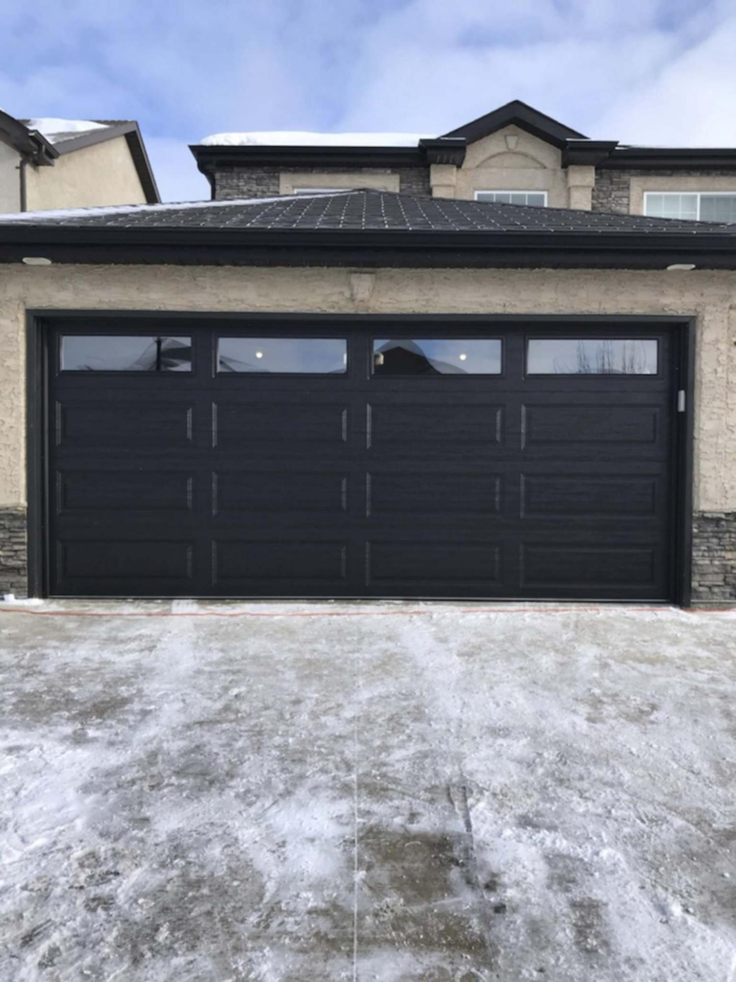 <p>Supplied photos / Trapp Doors</p><p>This new door with windows not only brings daylight into this garage, it also dramatically improved the home&rsquo;s curb-appeal over the old and weathered door. </p></p>