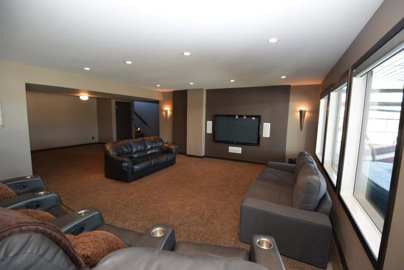 <p>The entertainment room is ready for family movies and football games.</p>