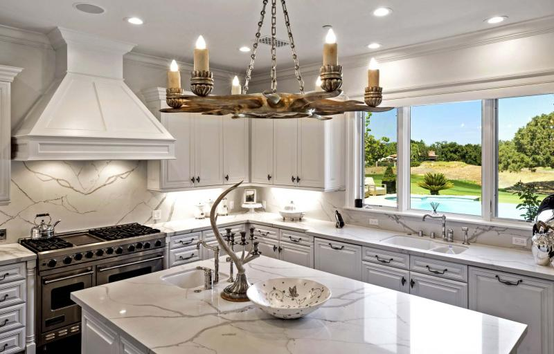 <p>Simon Berlyn / TNS</p><p>The home features marble countertops.</p></p>