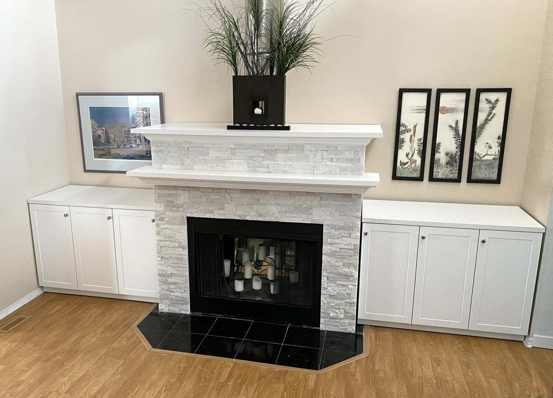 <p>Photos by Marc LaBossiere / Winnipeg Free Press</p><p>Side cupboards enhance the overall look of the fireplace, which was refreshed with shimmering white stone veneer. </p></p>