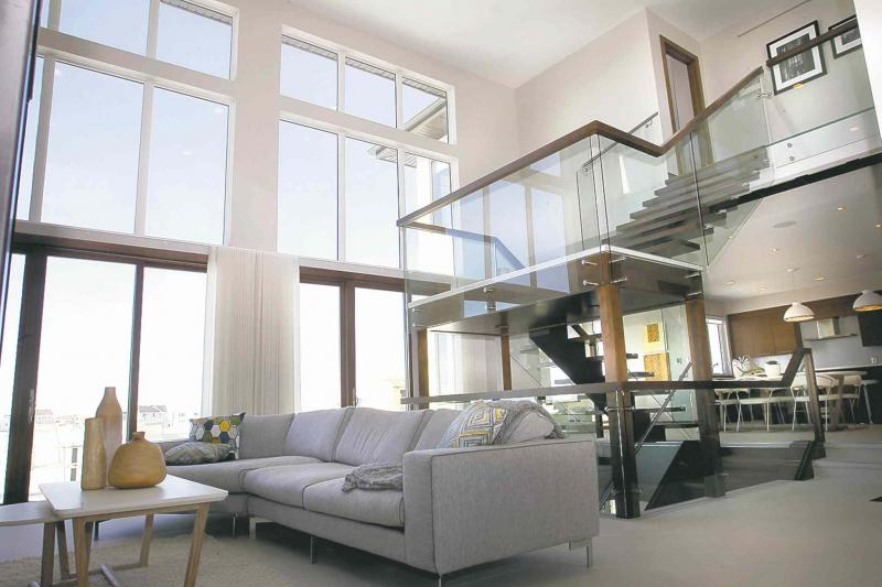 A Focal Point Of The Main Floor Of 28 Waterstone Is A Centre Staircase With  See Through Tempered Glass Sides, Stainless Rail Trim And Floating Maple  Stairs.