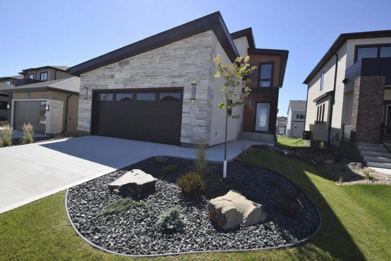 <p>The unique exterior of the Luxe in Bonavista invites you inside, where the home's interior is equally appealing, and functional as well. (Photos by Todd Lewys / Winnipeg Free Press) </p>
