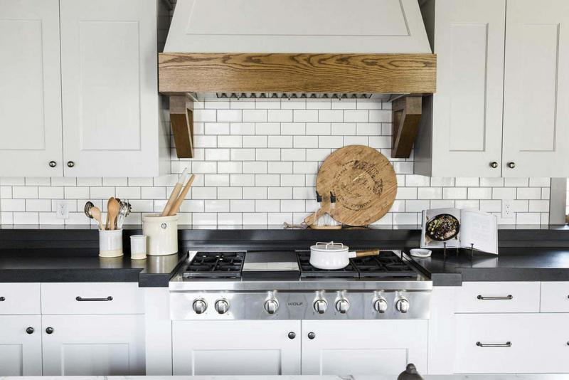 <p>PHOTOS BY Travis J. Photography</p><p>This Studio McGee kitchen features standard subway tile with a darker grout. Subway tile is a go-to because it pairs easily with so many different styles. Designers predict subway tiles will be favoured over small, offset tiles seen in 2018.</p>