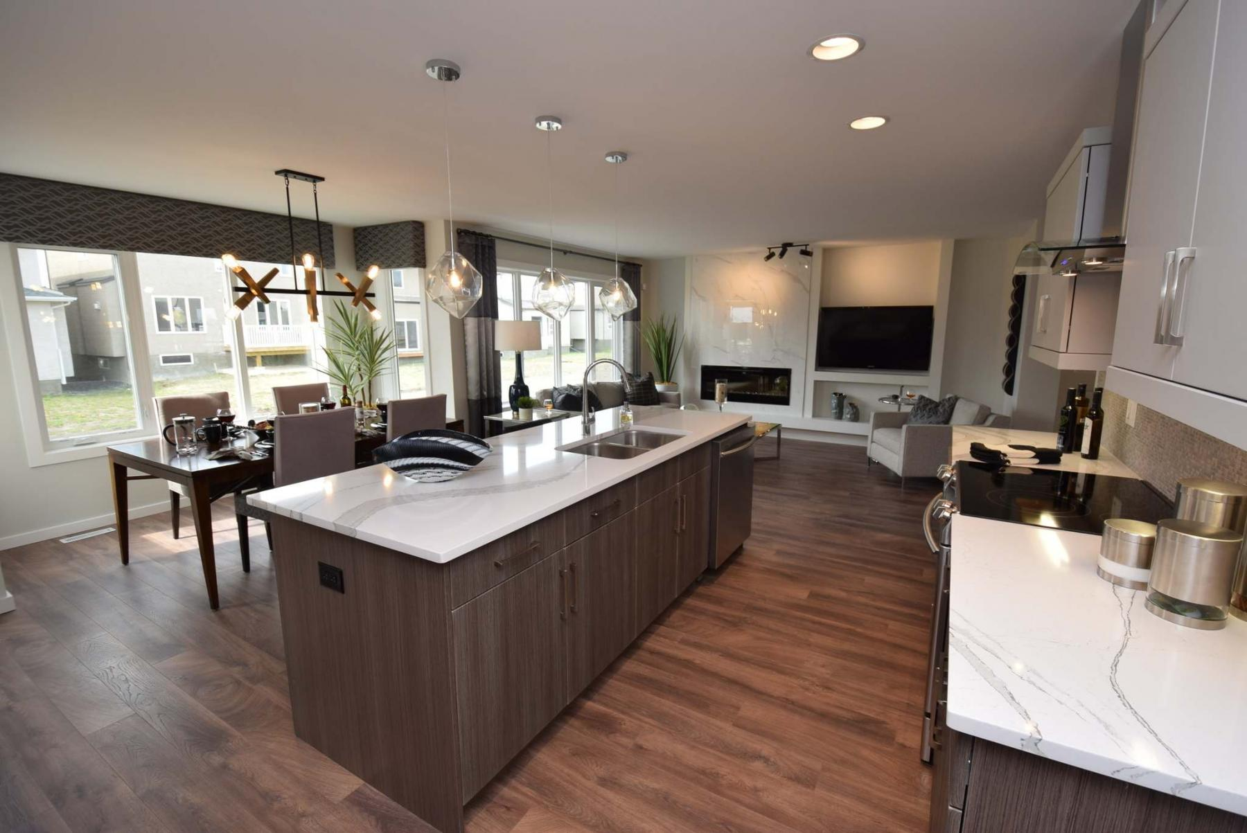 <p>Todd Lewys / Winnipeg Free Press</p><p>The kitchen's off-white/grey quartz countertops complement the rest of the finishes, like the main floor's laminate plank flooring, to create a warm, open feel.</p>