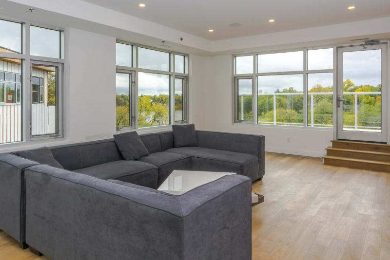 <p>supplied</p><p>The fourth floor of the Wildewood Village townhome is a four-season lounge featuring a collection of huge windows and access to balconies with commanding views.</p>