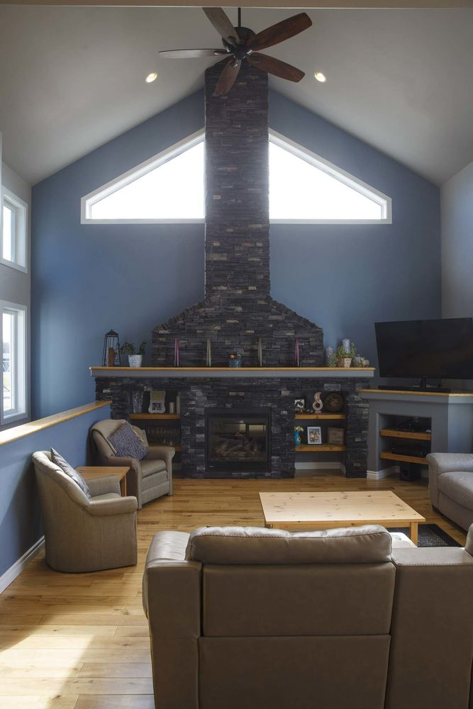 <p>MIKE DEAL / WINNIPEG FREE PRESS</p><p>The family room features a 22-foot-high vaulted ceiling and fireplace with soaring cultured stone surround and stack with angled windows.</p></p>
