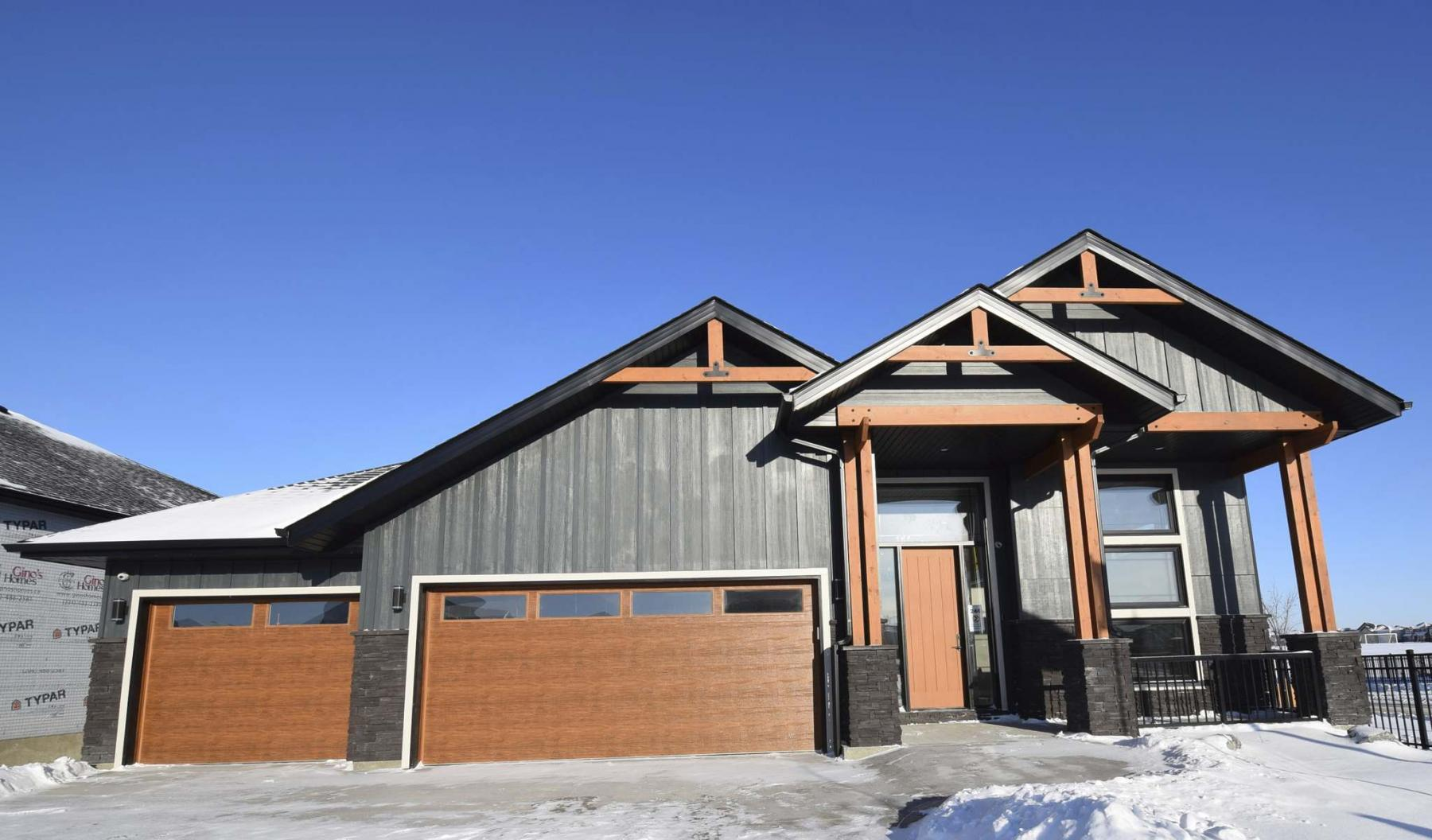 <p>Photos by Todd Lewys / Winnipeg Free Press</p><p>The 1,522 sq. ft. walk-out raised bungalow features an exterior clad with a mix of rustic and modern finishes.</p>