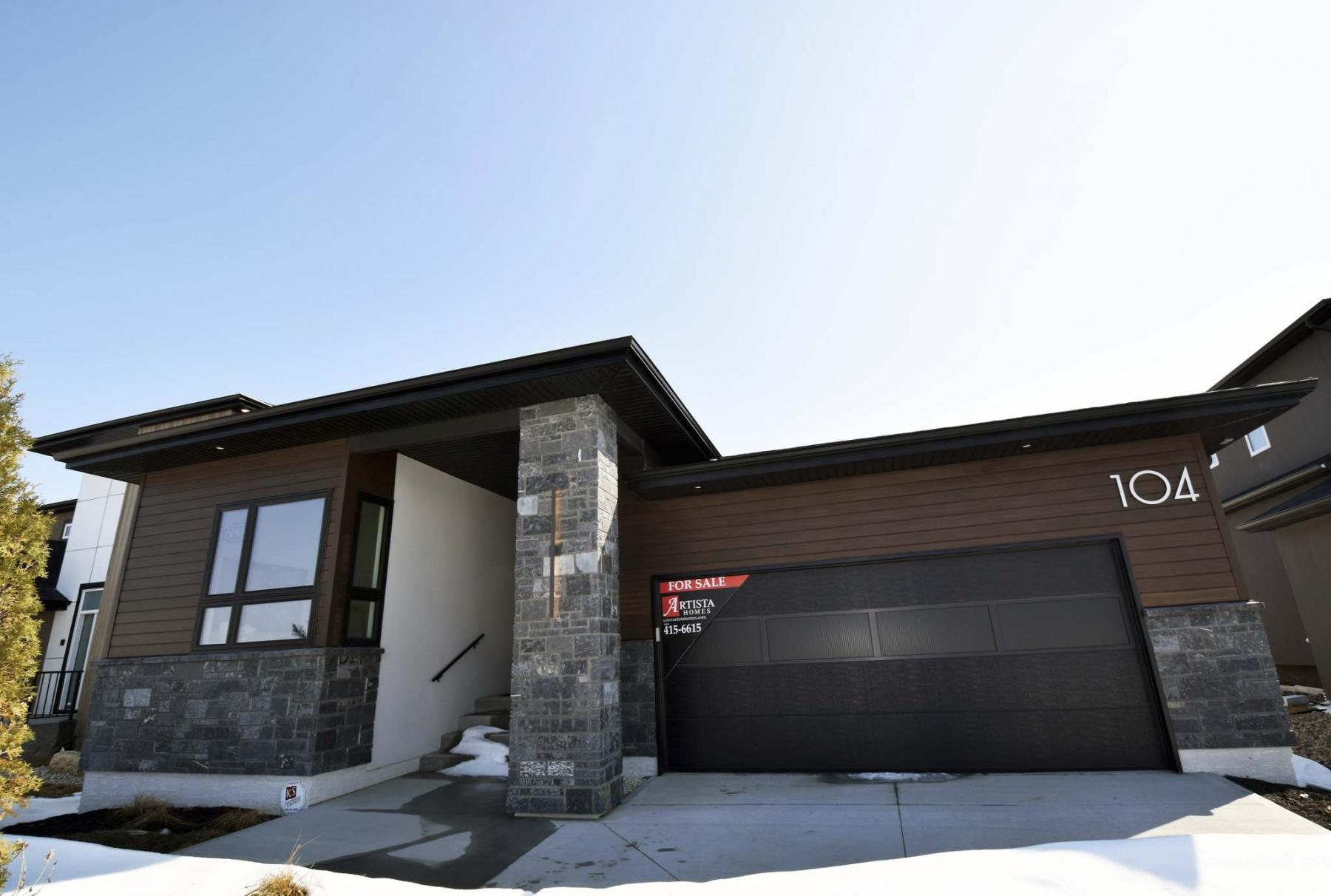 <p>Photos by Todd Lewys / Winnipeg Free Press</p><p>A simple, classy exterior is a prelude to this spacious bungalow's simple yet spectacular interior.</p>