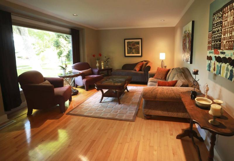 <p>RUTH BONNEVILLE / WINNIPEG FREE PRESS</p><p>The spacious living room of 18 Larchwood Place is cosy and full of natural light owing to a large picture window overlooking a wonderful view of mature tees.</p></p>