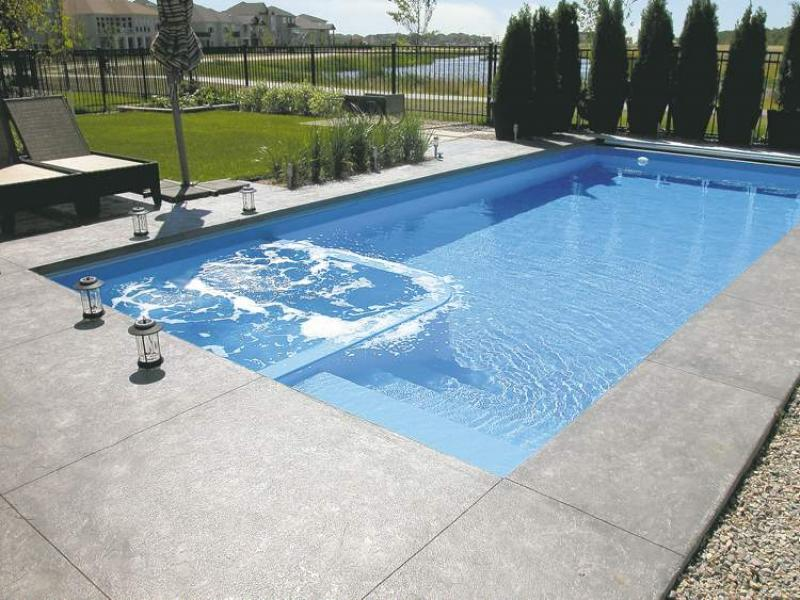 Renovations splish splash winnipeg free press homes for Pool design with hot tub