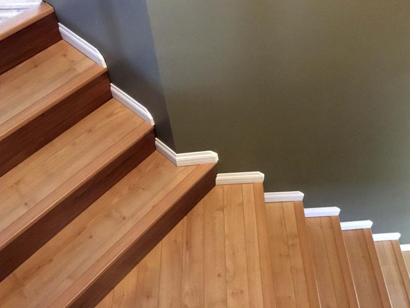 Anne Hebertu0027s Stair Treads In Laminate With Matching Stair Nosing, Risers  In A Darker Laminate, And White Baseboards On Every Stair And Landing.