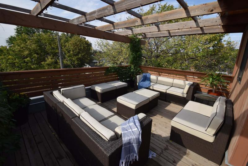 <p>Todd Lewys / Winnipeg Free PressOn the roof of the home is arguably it's greatest feature: a rooftop patio covered with a pergola.</p>