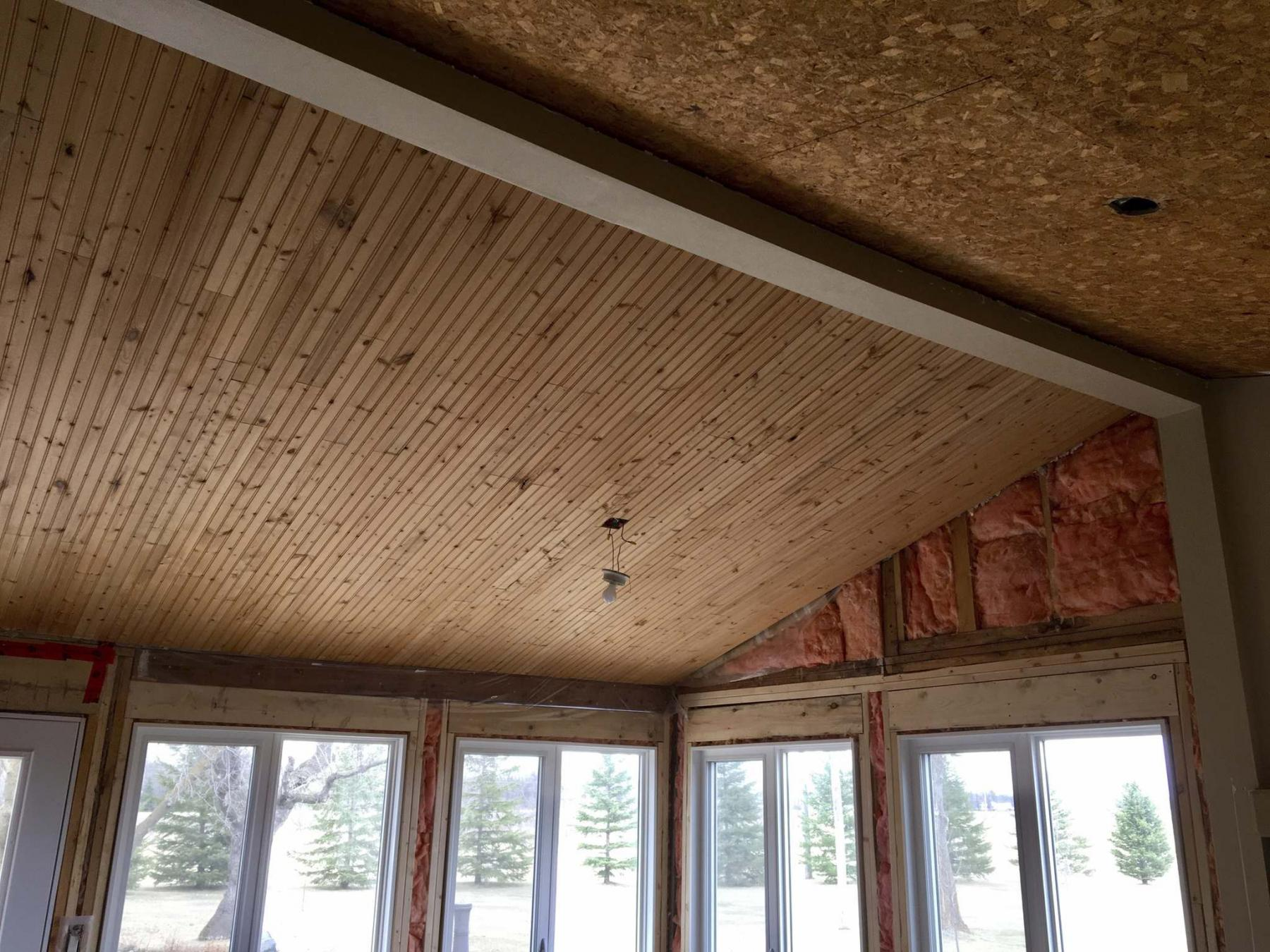 <p>Marc LaBossiere / Winnipeg Free Press</p><p>The tongue-and-groove pine from the kitchen side of the main beam was carefully removed, recycled and installed on the old porch side of the ceiling to make way for the new dining room area. </p>