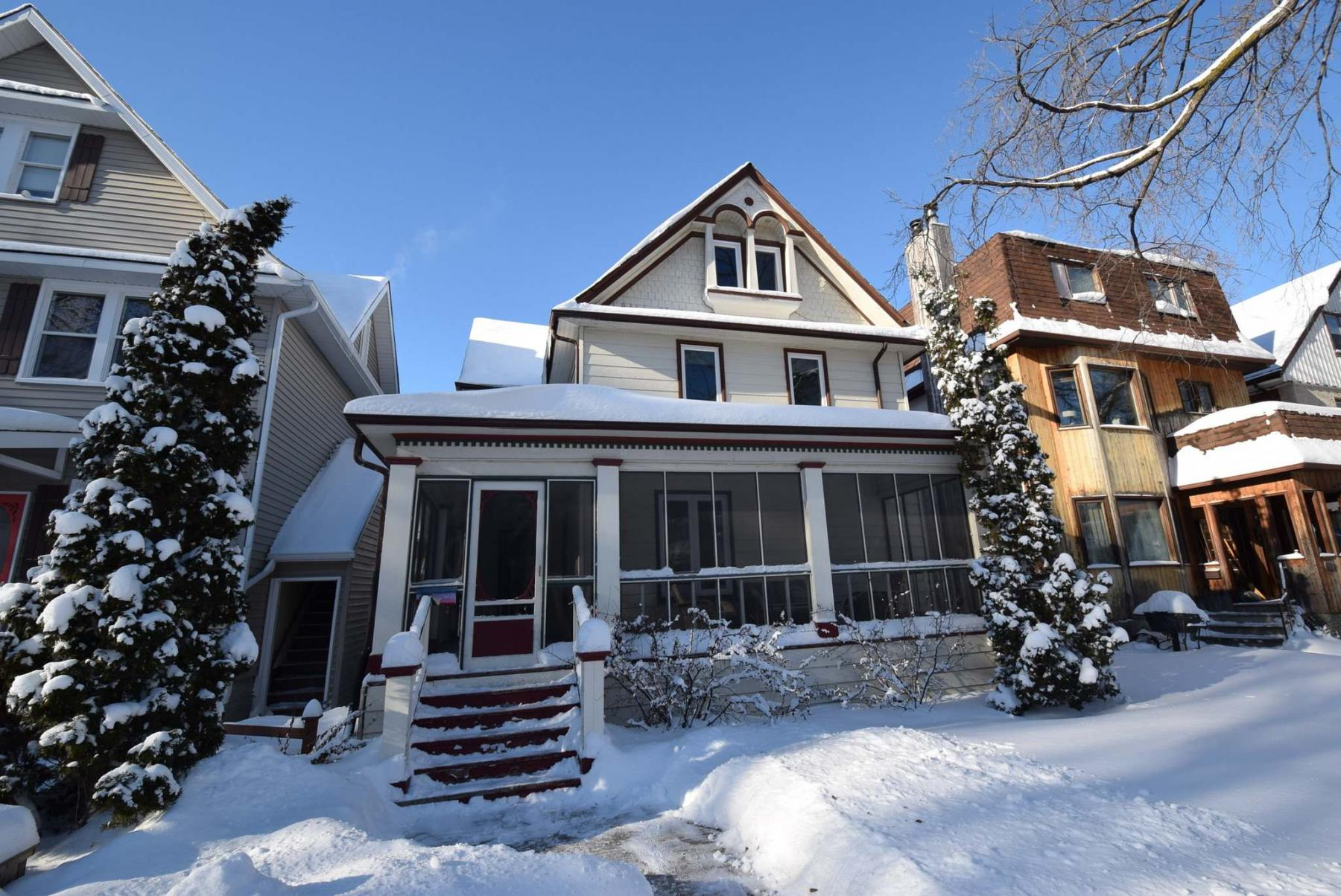 <p>Todd Lewys / Winnipeg Free Press</p><p>With its screened-in front porch, ornate windows and peaked roof, this home oozes character.</p>