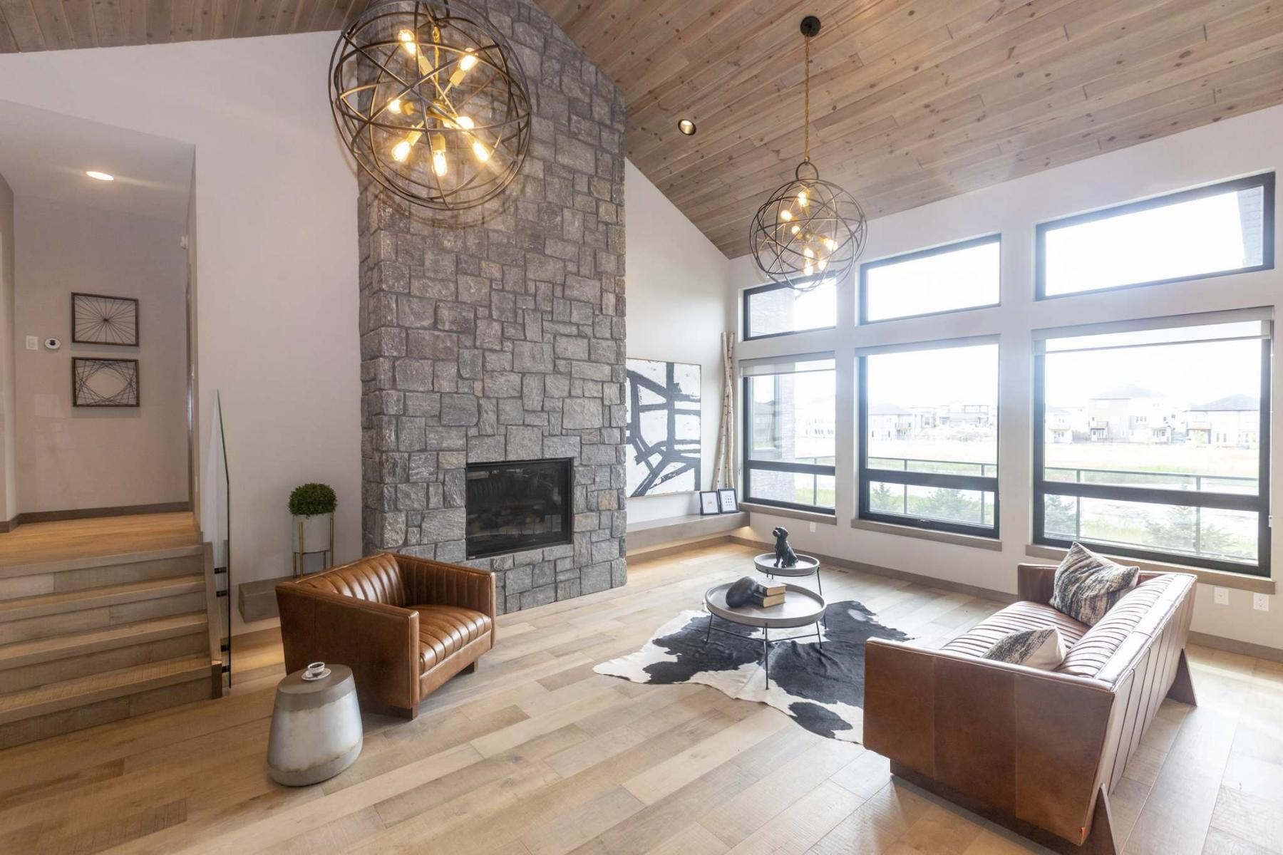 <p>SASHA SEFTER / WINNIPEG FREE PRESS</p><p>The great room at 352 Willow Creek Rd. is a voluminous space that evokes a genuine mountain lodge feel with its 16-foot vaulted ceiling, stone fireplace and large windows.</p></p>
