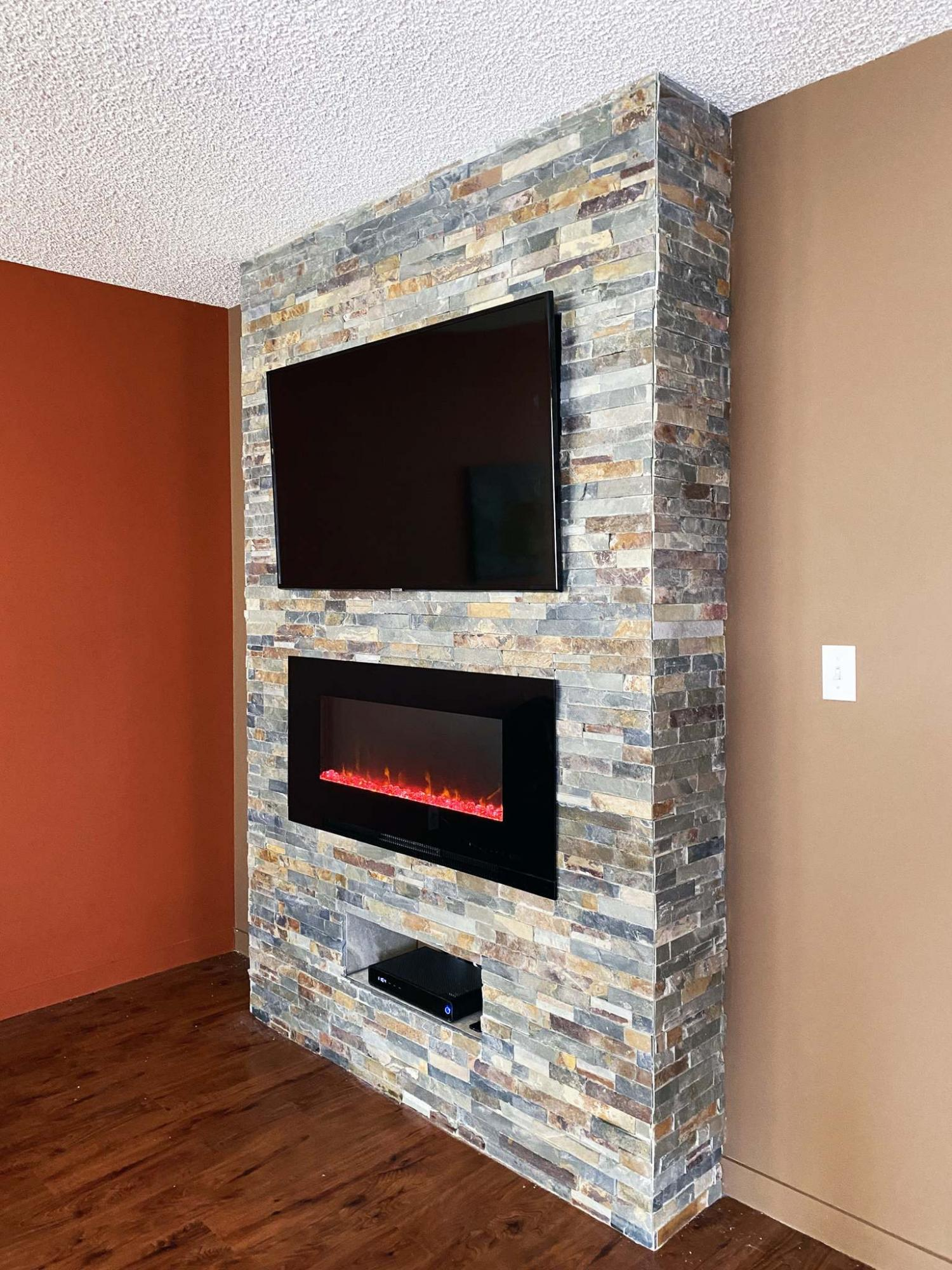 <p>Photos by Marc LaBossiere / Winnipeg Free Press</p><p>An interior decorative natural stone was used to sheath the exterior facades of the feature unit, while a smooth matching tile was used within the TV cavity and lower shelf. </p></p>