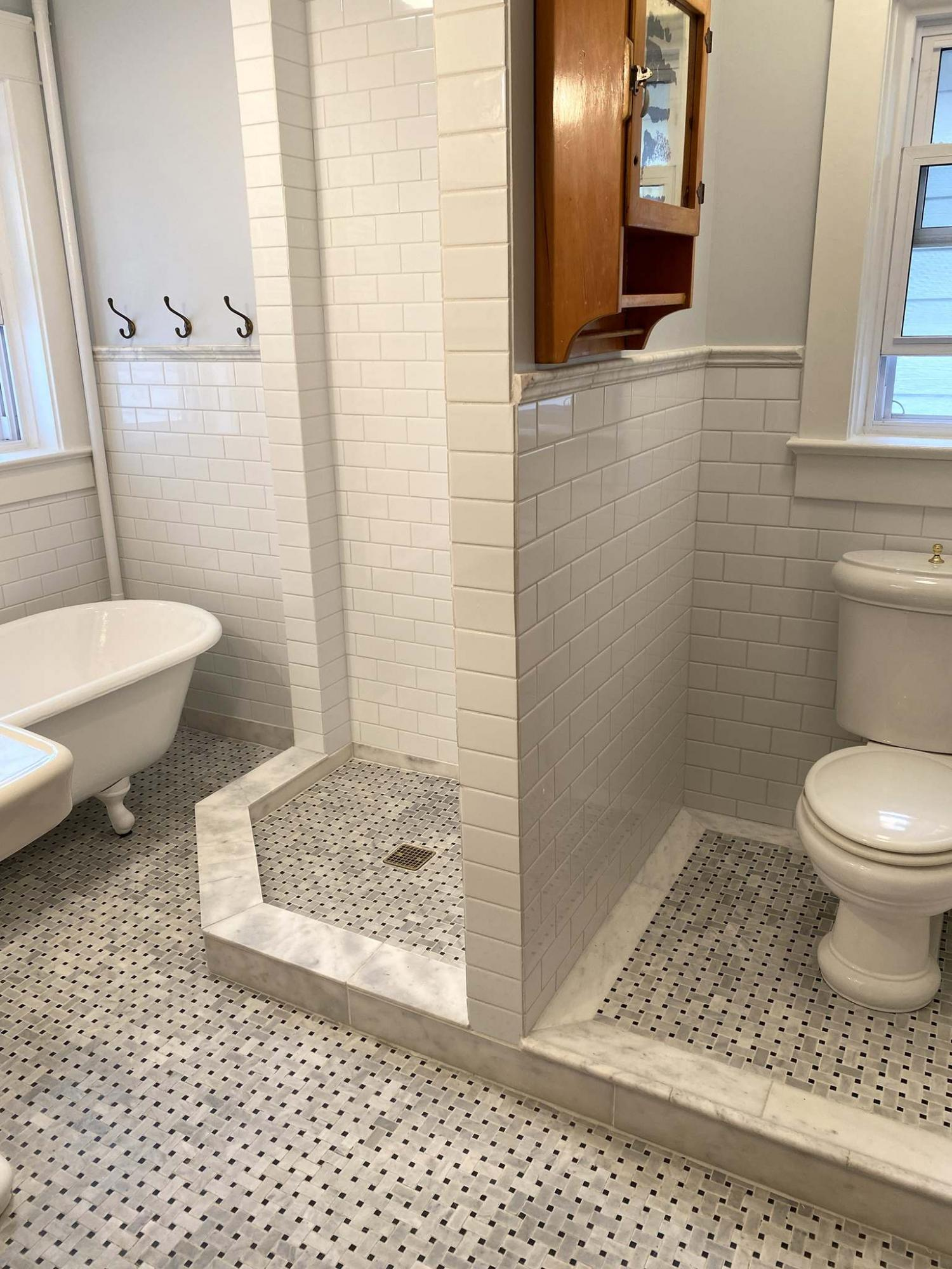 <p>Photos by Marc LaBossiere / Winnipeg Free Press</p><p>Tiling the water closet, which is higher than the main bathroom floor, presented a challenge. </p>