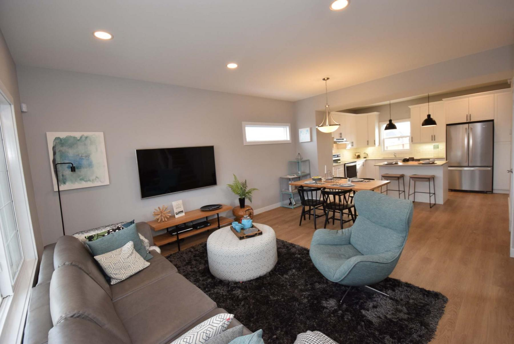 <p>Photos by Todd Lewys / Winnipeg Free Press</p><p>A nine-foot ceiling combines with an open-concept layout to make for a very functional great room in this Spring Parade of Homes entry.</p>