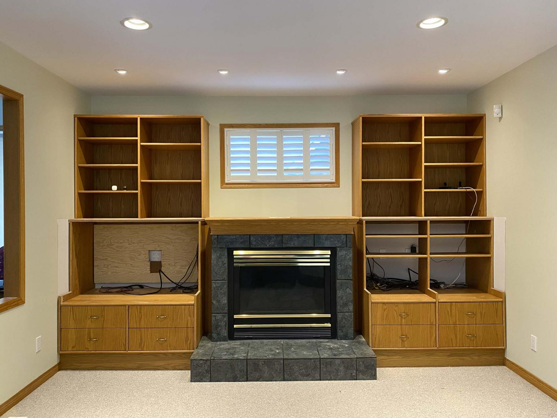 <p>Photos by Marc LaBossiere / Winnipeg Free Press</p><p>Once the middle cabinets on either side of the fireplace were cut back (above), the TV could be placed on the left. After existing oak edge trim was removed (below), the cut lines were marked on the cabinet and the shelves were completely removed to allow a clean cutting process.</p>